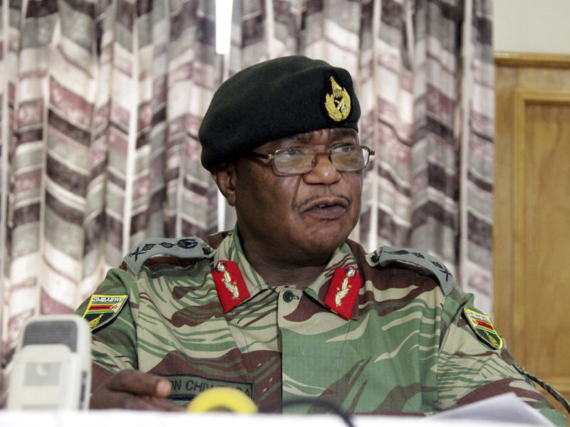 """Zimbabwe's Army Commander, Constantino Chiwenga threatened at a Monday news conference in Harare to """"step in"""" to calm political tensions over the president's firing of his deputy."""