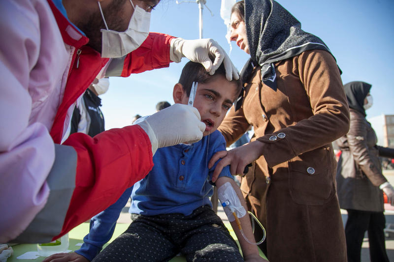<p>A wounded boy is treated following an earthquake in Sarpol-e Zahab county in Kermanshah, Iran.</p>