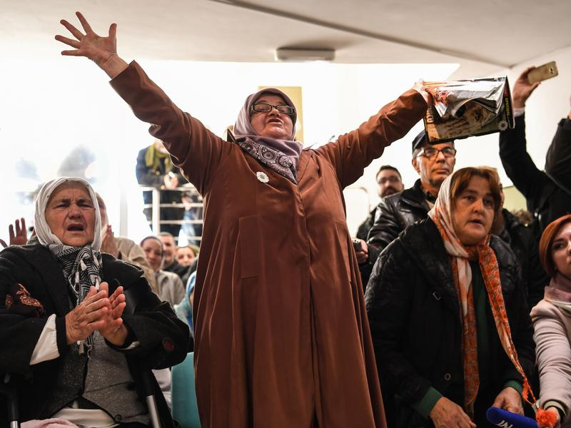 People celebrate as they watch a live TV broadcast on Wednesday in Srebrenica, when U.N. judges announce the life sentence in the trial of former Bosnian Serb commander Ratko Mladic, accused of genocide and war crimes in the brutal Balkans conflicts over
