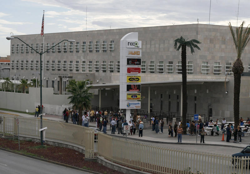 """<p dir=""""ltr"""">Visa-seekers stand outside the US Consulate in Ciudad Juarez in 2010.</p>"""