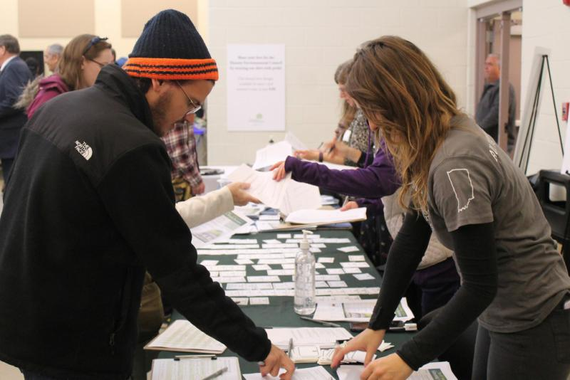 """An attendee checks in at the Hoosier Environmental Council's """"Greening the Statehouse."""" (Lauren Chapman/IPB News)"""
