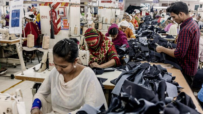 <p>These are garment workers at a factory making denim jeans. </p>