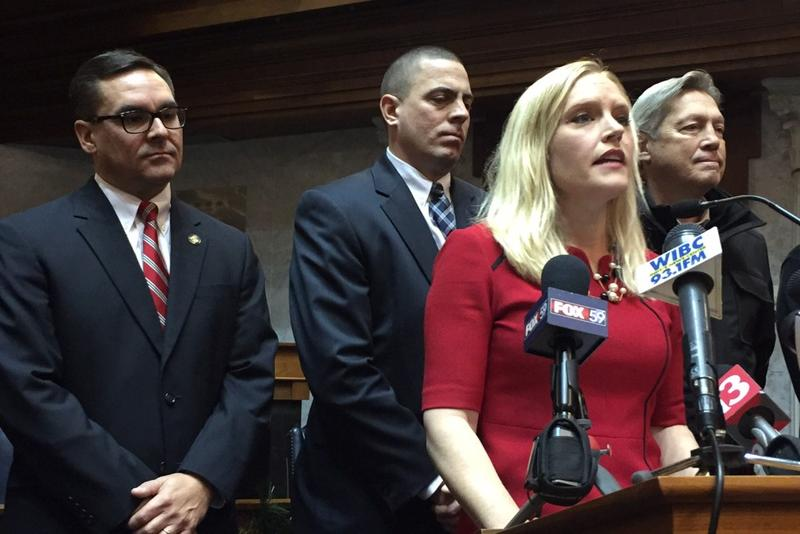 Sen. Erin Houchin (R-Salem) is surrounded by Indiana prosecutors when she announces in 2016 she'll author the felony arrestee DNA bill. (Brandon Smith/IPB News)