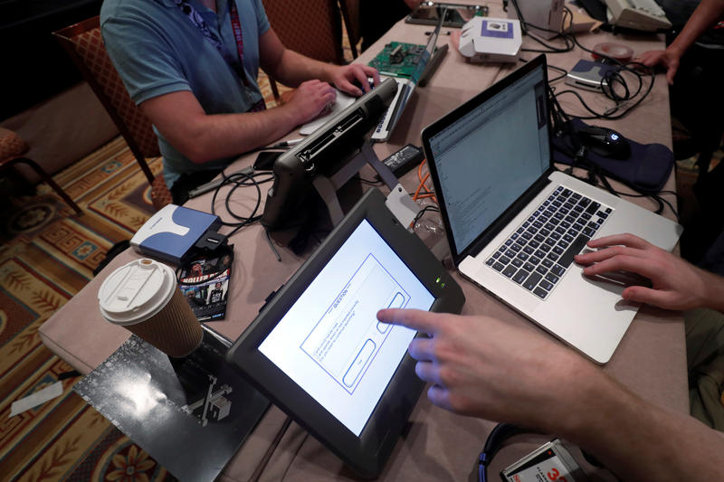 <p>Hackers try to access and alter data from an electronic poll books in a Voting Machine Hacking Village during the Def Con hacker convention in Las Vegas.</p>