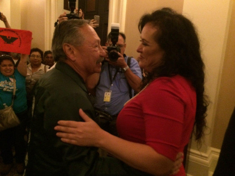 United Farm Workers President Arturo Rodriguez (left) embraces Asm. Lorena Gonzalez (D-San Diego) after the Assembly approved her AB 1066 on Monday, Aug. 29, 2016.