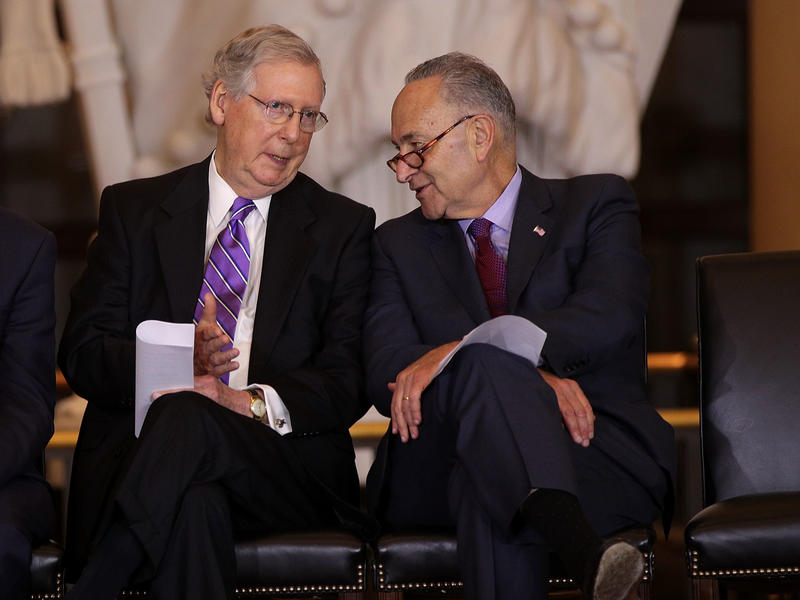 U.S. Senate Majority Leader Mitch McConnell (left) chats with Senate Minority Leader Chuck Schumer in October. The two negotiated a budget agreement that marks a major breakthrough for a Congress still reeling from a partial government shutdown last month