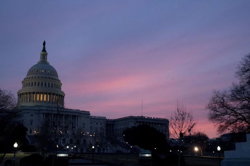 The Capitol Dome of the Capitol Building at sunrise, Friday, Feb. 9, 2018, in Washington. After another government shutdown, congress has passed a sweeping long term spending bill which President Trump is expected to sign later this morning. (Andrew Harni