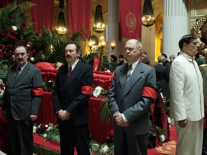 Stalin's Dead and Red in The Death of Stalin. L to R: Dermot Crowley as Kaganovich; Paul Whitehouse as Mikoyan; Steve Buscemi as Krushchev; Jeffrey Tambor as Malenkov; Paul Chahidi as Bulganin.
