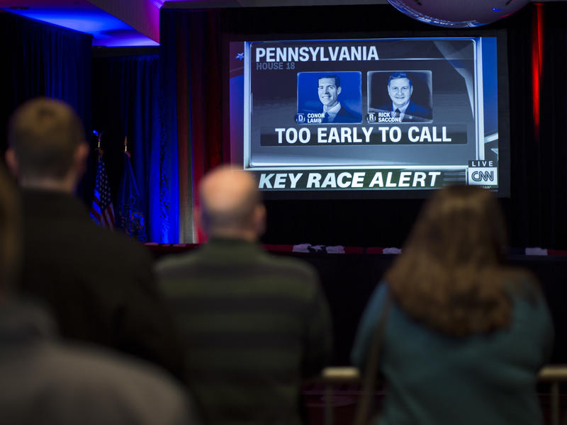 Supporters of Democratic congressional candidate Conor Lamb await results on Tuesday night in Canonsburg, Pa. Lamb and Republican Rick Saccone were locked in a race that was declared too close to call hours after polls closed.