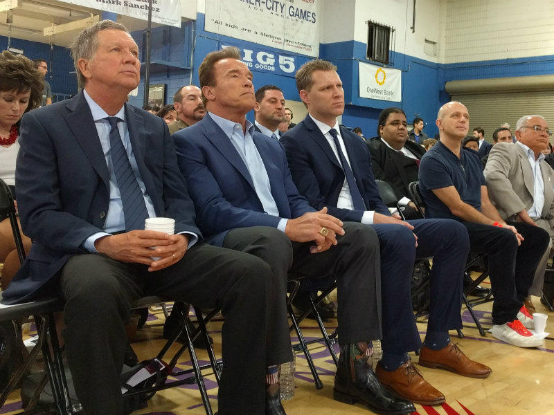 From left: Ohio Governor John Kasich, former California Governor Arnold Schwarzenegger and Assemblyman Chad Mayes (R-Yucca Valley) sit at the beginning of the first New Way California event in Los Angeles.