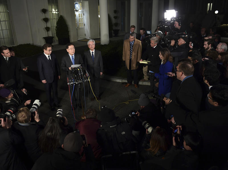 South Korean national security adviser Chung Eui-yong speaks to reporters at the White House Thursday evening. South Korean intelligence chief Suh Hoon is at left.
