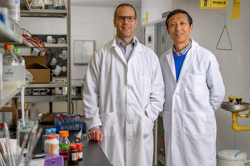 "Purdue University researchers Jean-Christophe ""Chris"" Rochet and Dr. Riyi Shi say their discovery of a key factor in the development of Parkinson's disease could lead to new therapies. (Photo courtesy of Alex Kumar/Purdue University)"