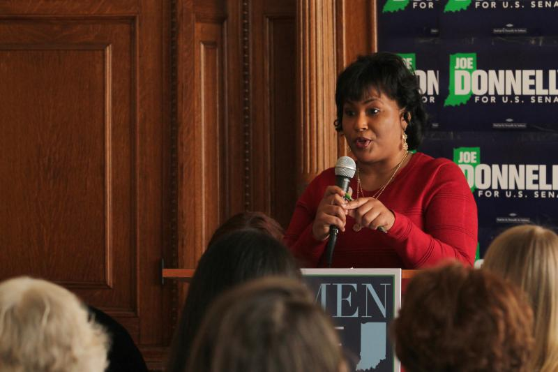 Rep. Cherrish Pryor (D-Indianapolis) shares her experiences with U.S. Sen. Joe Donnelly with a crowd in Indianapolis. (Lauren Chapman/IPB News)