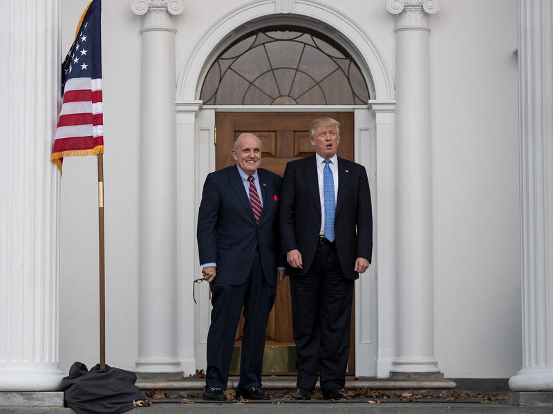 Former New York City Mayor Rudy Giuliani stands with then-President-elect Donald Trump before a meeting at Trump International Golf Club, in Bedminster Township, N.J., less than two weeks after Trump won the presidential election in 2016.