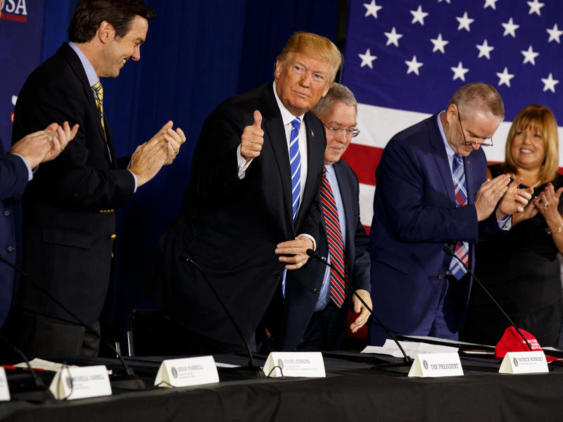 At an event in West Virginia this month, President Trump was seated between Rep. Evan Jenkins (to his right) and state Attorney General Patrick Morrisey, both of whom are running for the Senate.