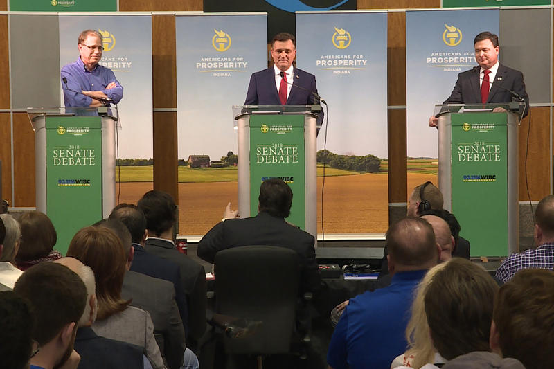 Republican U.S. Senate candidates – Congressmen Luke Messer and Todd Rokita, and businessman Mike Braun – went head-to-head the first time in February at an Americans For Prosperity debate. (Barbara Brosher/WTIU)