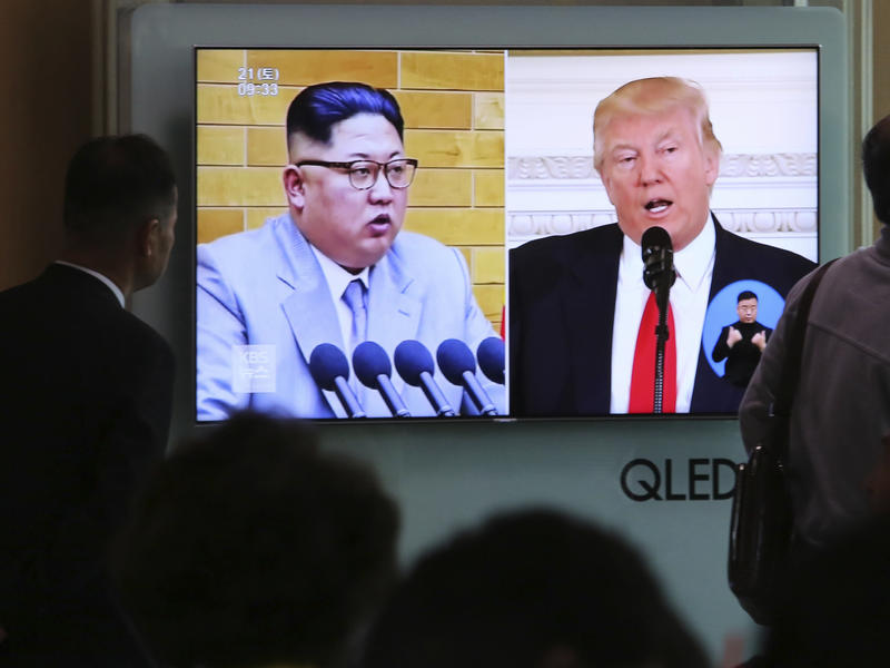 People at Seoul Railway Station in South Korea on Saturday watch a TV screen showing file footage of U.S. President Trump and North Korean leader Kim Jong Un during a news program. North Korea says it has suspended nuclear and long-range missile tests and