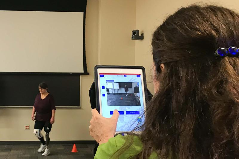 Army veteran Rosemary Salak performs exercises with physical therapist Barbara Springer as part of her participation in a study of the ReLoad app.
