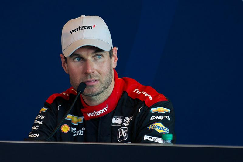 Will Power listens to a question during a press conference after winning the Indianapolis 500 on Sunday. (Doug Jaggers/WFYI News)