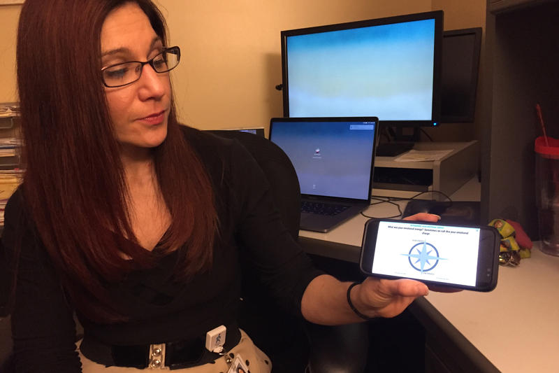 Indiana University School researcher Dawn Neumann demonstrates the My Emotional Compass app. (Jill Sheridan/IPB News)