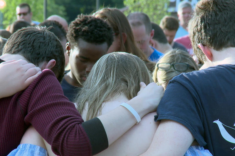 Noblesville students embrace for a community prayer during the vigil. (Lauren Chapman/IPB News)