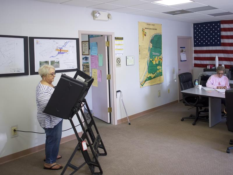 A woman casts her ballot at the Conyngham Township Municipal Building polling station in Mocanaqua, Pa., on Tuesday.