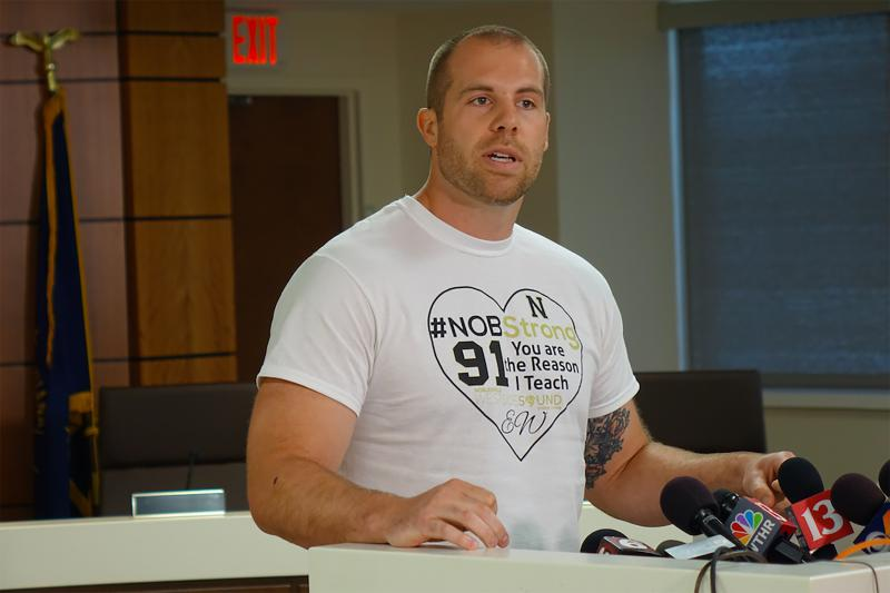 Seventh grade teacher Jason Seaman, who is credited with tackling the shooter at Noblesville West Middle School, speaks at a press conference Monday. (Eric Weddle/WFYI News)