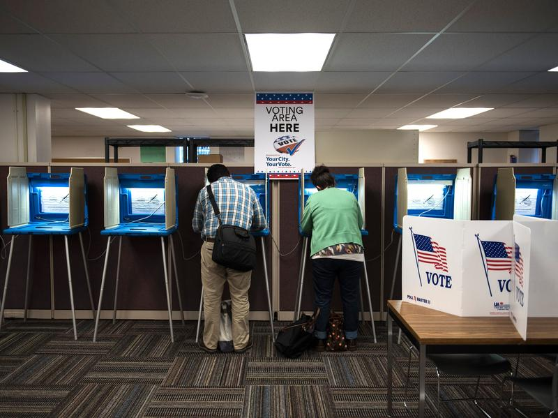 Joseph and Maria Caruso vote inside the Early Vote Center in downtown Minneapolis on Oct. 5, 2016. The Supreme Court on Thursday struck down a Minnesota law that prohibited voters from wearing politically themed items inside polling places.