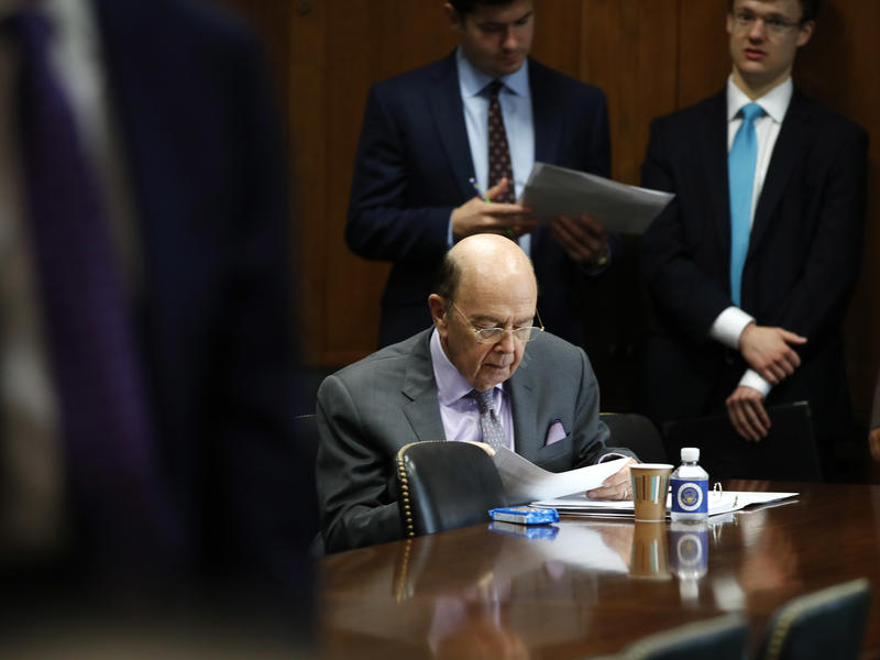 Commerce Secretary Wilbur Ross prepares ahead of a Senate hearing on tariffs on June 20, in Washington, D.C.