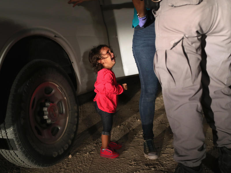 A 2-year-old Honduran girl cries as an official searches her mother near the U.S.-Mexico border earlier this month in McAllen, Texas. For many, the image has become indelibly associated with a Trump administration policy that for weeks separated migrant c
