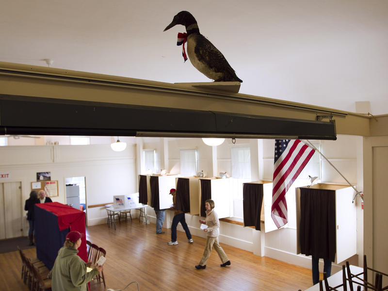 Voters cast their ballots in the Old Town Hall on Westport Island, Maine. This Tuesday, ranked-choice voting will be put to its biggest test when Maine uses the system in a statewide primary election.
