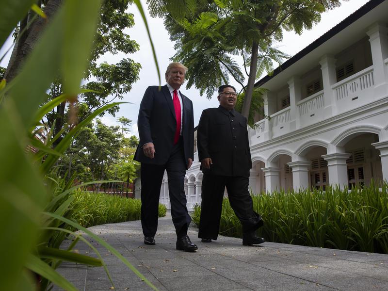 President Trump walks with North Korean leader Kim Jong Un on Tuesday on Sentosa Island in Singapore.