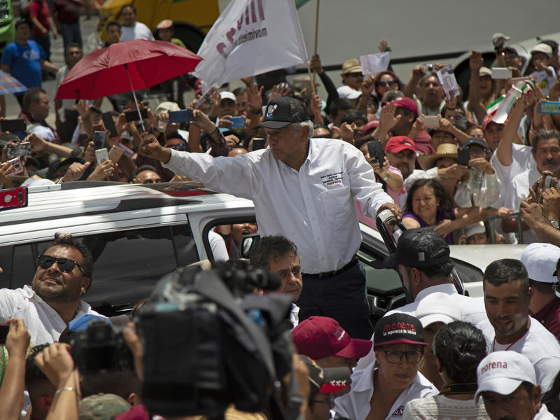 López Obrador gestures to supporters as he ends his campaign rally in Mexico City on June 3.