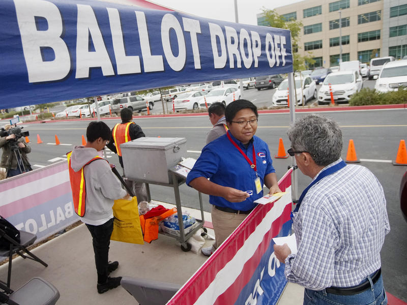 Motorists in San Diego drop off their ballots Tuesday at the Registrar of Voters. Eight states, including California, are holding primary elections on Tuesday, and there are several highly competitive races, including for governor and U.S. House and Senat