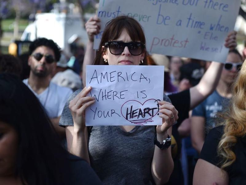 Critics of U.S. government policy that separates children from their parents when they cross the border illegally from Mexico protest in downtown LA on June 14.
