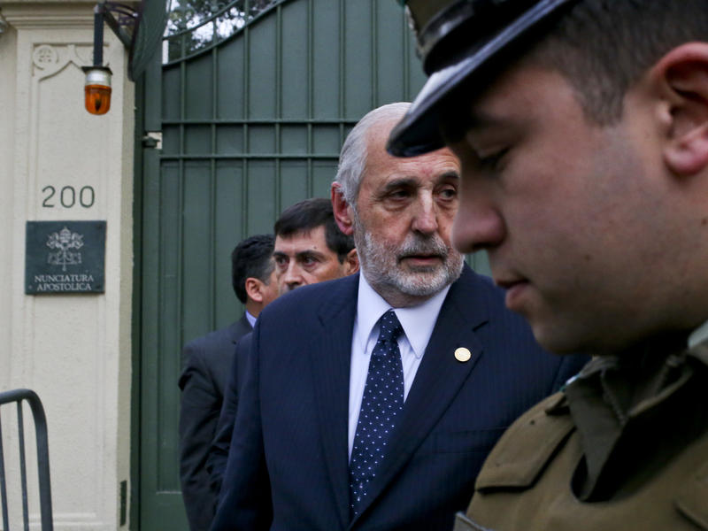 Chile's National Prosecutor Jorge Abbott, center, leaves the Apostolic Nunciature after meeting with Archbishop Charles Scicluna in Santiago, Chile. Police raided Roman Catholic Church offices in two Chilean cities Wednesday looking for files related to a