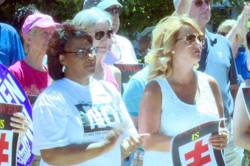 Reps. Cherrish Pryor (D-Indianapolis) and Karlee Macer (D-Indianapolis) joined the protest at the statehouse Saturday. (Lauren Chapman/IPB News)