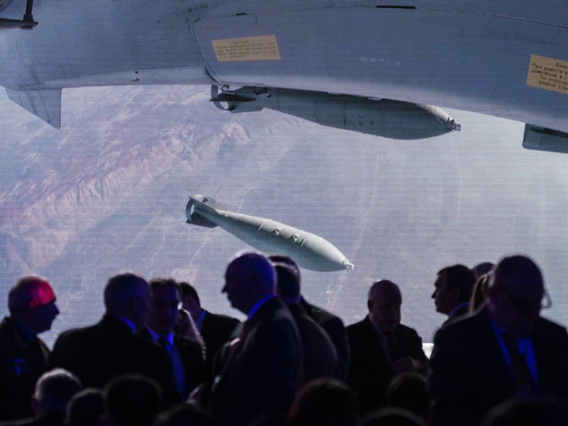 Participants at a global security conference in Moscow in April gather near a big screen showing a Russian warplane unloading its weapons over a target in Syria. Russia became involved in the Syrian civil war in 2015 in support of its ally President Basha