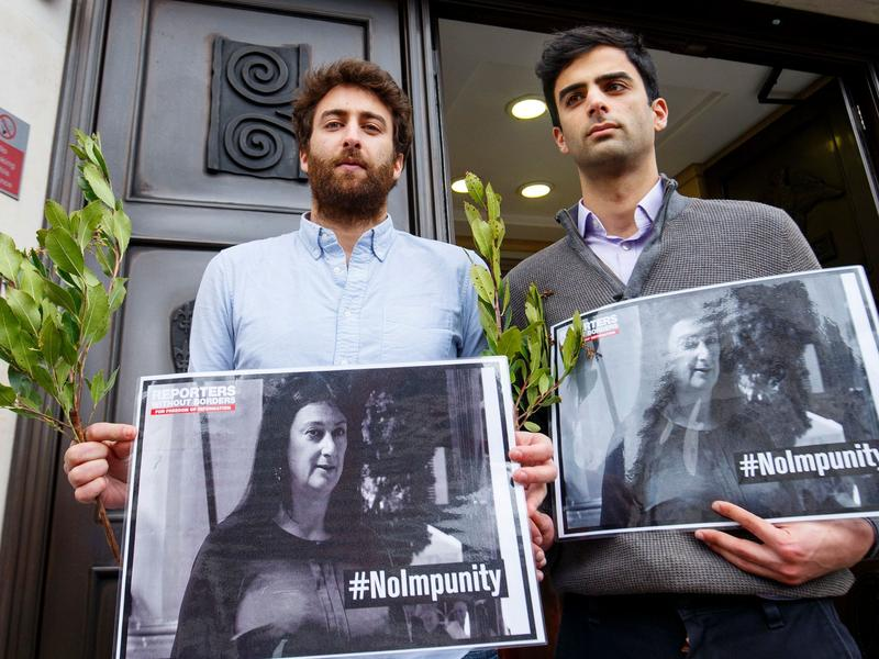 Matthew Caruana Galizia (left) and Paul Caruana Galizia, the sons of murdered Maltese journalist Daphne Caruana Galizia, attend a vigil outside the Maltese High Commission in London on April 16, six months after she was assassinated.