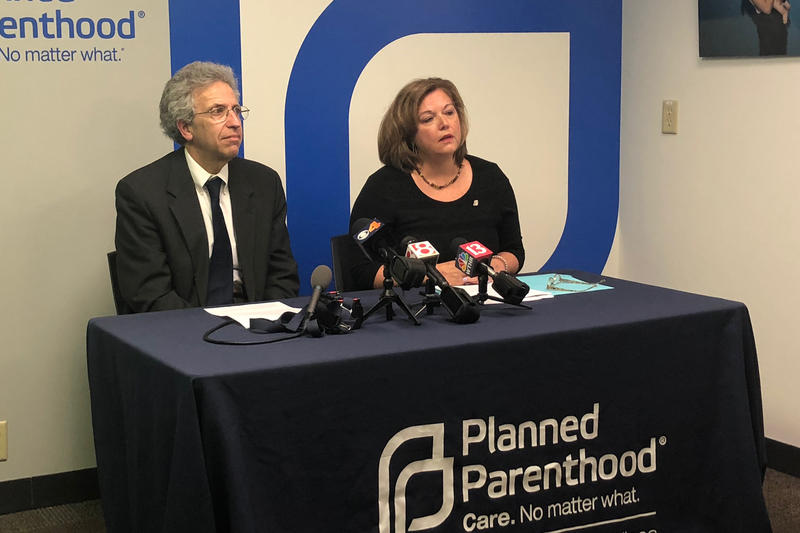 ACLU of Indiana Legal Director Ken Falk (left) and Planned Parenthood of Indiana and Kentucky CEO Christie Gillespie (right) discuss a federal judge halting Indiana's abortion reporting law. (Sarah Panfil/WFYI)