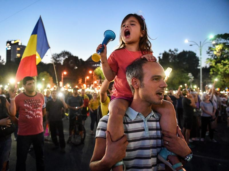 Anti-government protesters rally at Victoriei Square in front of government headquarters in Bucharest, Romania, on Sunday. Hundreds were injured during Friday's mass demonstration.
