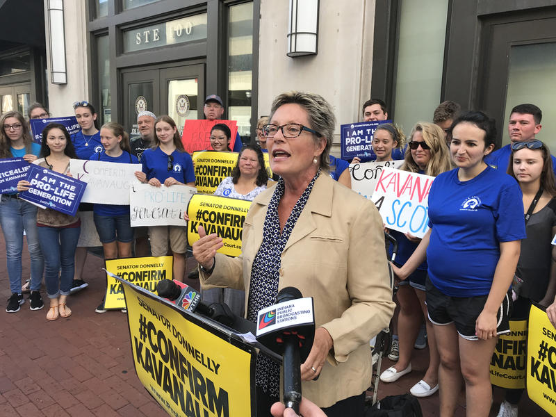 Susan B. Anthony List Indiana chair Sue Swayze Liebel leads a demonstration outside the Indianapolis office of Sen. Joe Donnelly (D-Ind.). (Brandon Smith/IPB News)