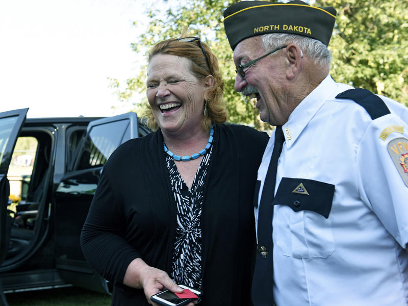 Sen. Heidi Heitkamp, D-N.D., reacts while speaking with an attendee at the West Fargo Police Department's Night to Unite event Aug. 7. Heitkamp is one of 10 Senate Democrats facing re-election in November in states President Donald Trump won in 2016.