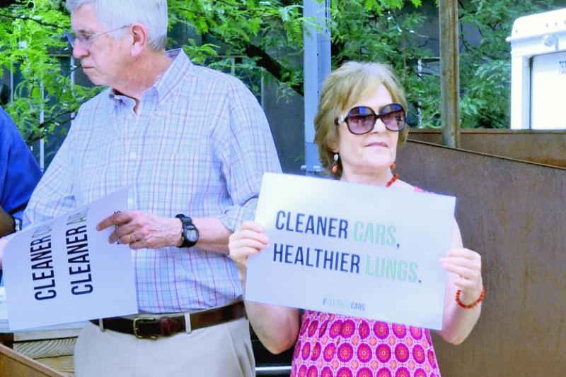 At a press conference in July, environmentalists and others opposed the EPA's plans to roll back clean car standards. (Rebecca Thiele/IPB News)