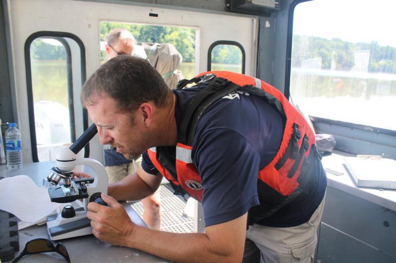 An ORSANCO member checks water samples during routine algae monitoring. (@ORSANCOchannel/Twitter)