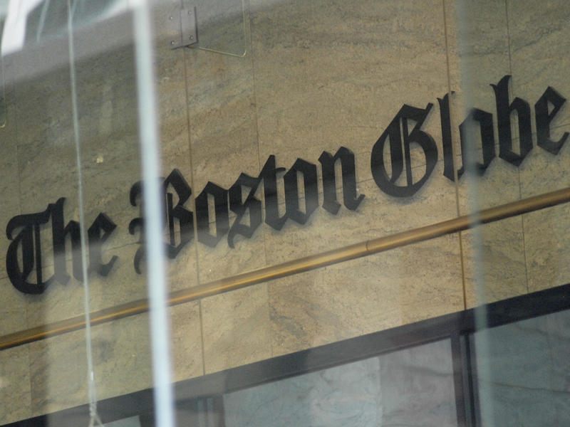 The Boston Globe's logo as seen through the windows across from the new location of the Globe in Boston. The paper's editors coordinated a campaign defending a free press in editorials.