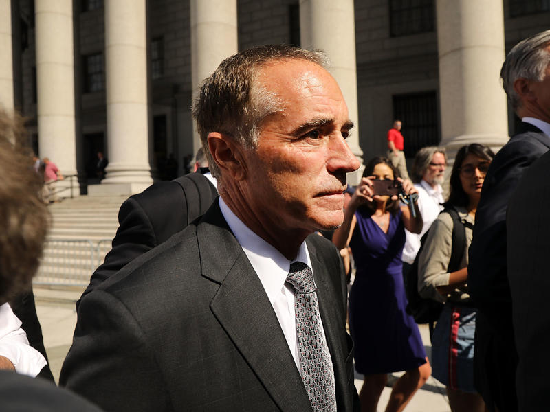 """Rep. Chris Collins, R-N.Y., walks out of a New York court house after being charged with insider trading on Wednesday. Democrats are seizing on the case to convince voters the GOP has a """"culture of corruption."""""""
