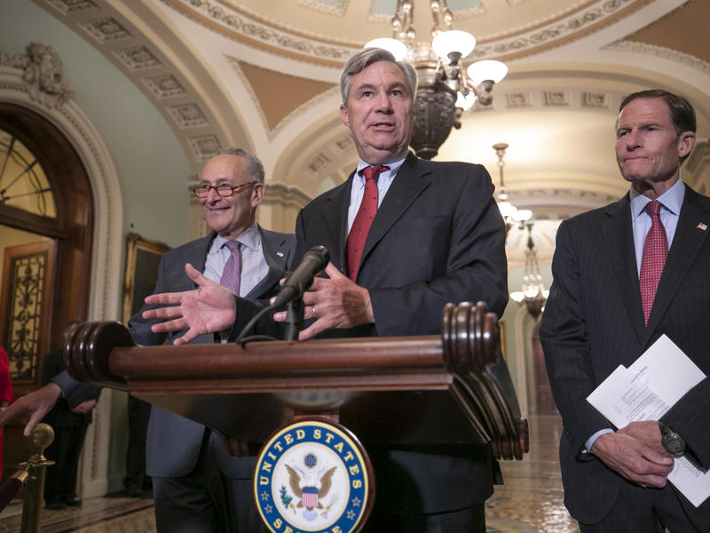 Sen. Sheldon Whitehouse, D-R.I., flanked by Senate Minority Leader Chuck Schumer, D-N.Y., left, and by Sen. Richard Blumenthal, D-Conn., hold a press conference on Aug. 16, 2018 saying they will sue the National Archives if they didn't get documents on Su