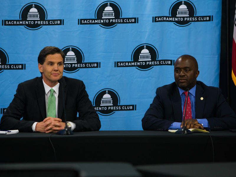 Marshall Tuck and Tony Thurmond, candidates for California's superintendent of public instruction, debate at the Sacramento Press Club on September 11, 2018.