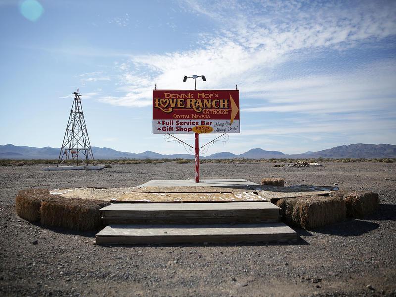 Signs for Dennis Hof's Love Ranch Las Vegas brothel in Crystal, Nev. in October 2015.